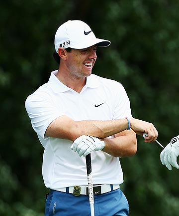HAPPY PLACE: Rory McIlroy is all smiles during a practice round for the PGA Championship at the Valhalla Country Club.