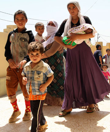 ESCAPE: A Yazidi family who made it out of Sinjar to a Kurdish controlled area.