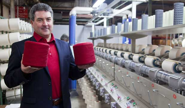 Andy Wynne, the chief executive of The Merino Company-Levana textiles, with some of the yarn and machinery at the Levin factory.