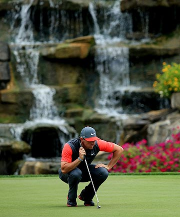 FOCUS: Wolrd No 1 Rory McIlroy eyes up a putt during his five-under par opening round at the PGA Championship.