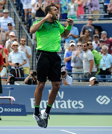 BIG WIN: Frenchman Jo-Wilfried Tsonga celebrates after securing his upset victory over world No 1 Novak Djokovic in the third round of the Rogers Cup tournament.