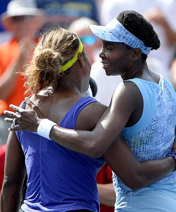 WELL DONE SIS: Serena Williams congratulates her older sister Venus after their semifinal at the Rogers Cup in Montreal.