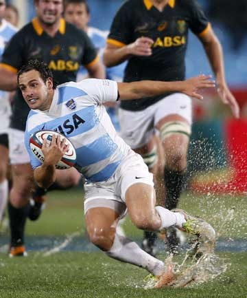 Argentina's Nicolas Sanchez attempts to sidestep a South African defender during their Rugby Championship match at Loftus Versfeld stadium in Pretoria.