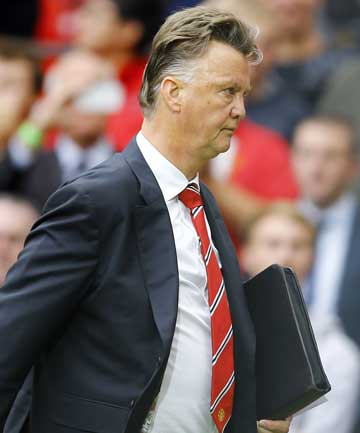Manchester United manager Louis van Gaal leaves the pitch following their opening English Premier League match defeat against Swansea City at Old Trafford.
