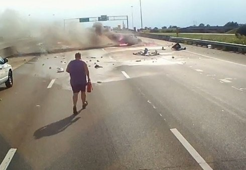 Truck driver in US is being hailed as a hero after pulling a grandmother and a one-year-old from a flaming car wreck.