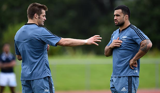 IN THE LOOSE: Liam Messam and captain Richie McCaw discuss tactics at All Blacks training earlier this week.