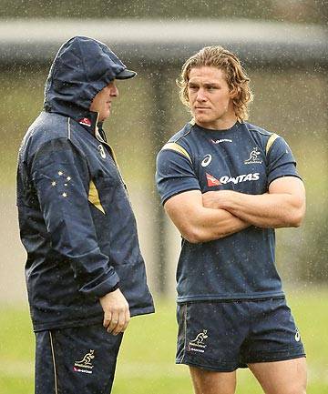 LEADERS: Wallabies coach Ewen McKenzie and captain Michael Hooper talk tactics at a training session yesterday.