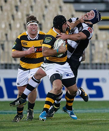 STIFF ARM: Taranaki back Charlie Ngatai puts a big fend on during his team's narrow NPC loss to Hawke's Bay tonight.