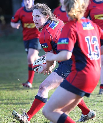 FOCUSSED: Southland Girls' High Schools' Louise Calder looks to pass in a college rugby final at Centrepoint Park, Sandy Point, last week.