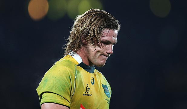 DEJECTED: Wallabies captain Michael Hooper trudges off Eden Park after his team was hammered by the All Blacks on Saturday night.
