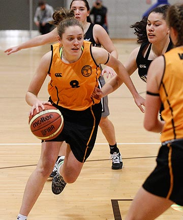 COMING THROUGH: Junior Tall Ferns squad member Tegan Graham on the attack for Wellington Girls' in the premier one girls