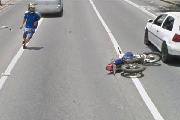 A motorcyclist crashes in front of the Google Street View camera car in Brazil.