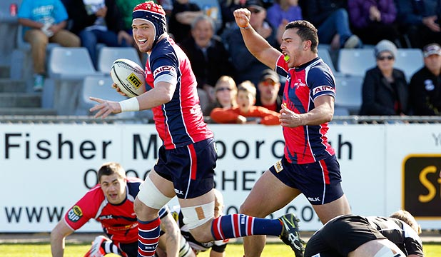 YOU BEAUTY: Tasman fullback James Lowe raises his arms as lock Joe Wheeler goes over for an early try during the Makos round one victory over Hawke's Bay in this year's NPC.