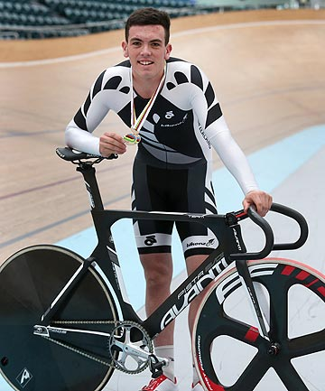 TERRIFIC RIDE: Southland cyclist Nick Kergozou celebrates his bronze medal win as part of the BikeNZ team pursuit squad at the junior world track cycling champs in Korea. It was the 18-year-old's first taste of representing his country.