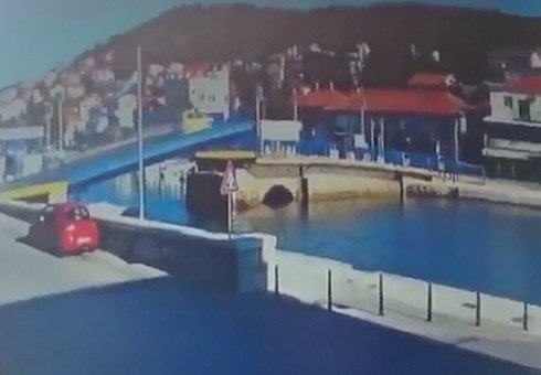 A driver's inattention has led to a drawbridge stunt that would not be out of place on a movie set.