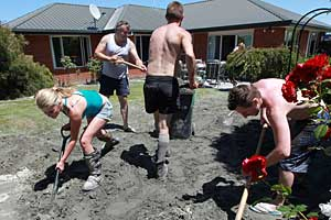 Neighbours helping clear liquefaction