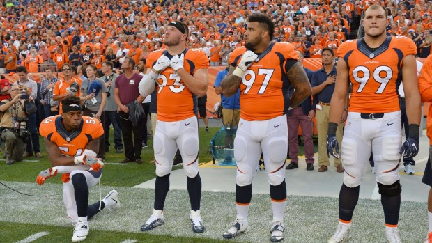 Denver's Brandon Marshall takes knee during national anthem