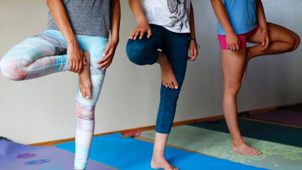 Yoga trousers parade to protest man's comments on women's wear