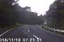 Dash cam footage captures car narrowly miss oncoming truck in West Auckland