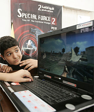 FAMILY FUN: Children play the computer game 'Special Force 2', which puts players on the frontline of a war against Israel.