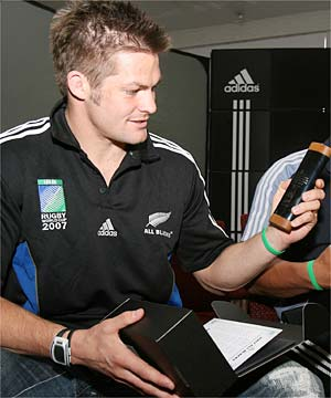 DIRTY: ABs skipper Richie McCaw examines his capsule of dirt, sourced from every NZ rugby ground trodden on by one of the 1071 All Blacks, a little piece of home to take to the World Cup.