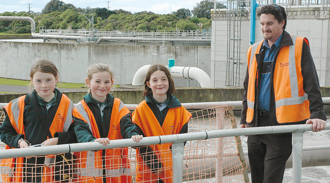 INQUIRING: Watercare's Jonathan Piggot with Rachael White, 9, Georgia Dakin and Molly Bennett, both 8, from Meadowbank School.