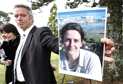 VICTIM: Detective Grant Coward holds a photo of German backpacker Birgit Brauer the German backpacker who was murdered by  Michael Scott Wallace.