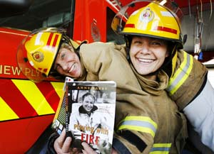 The country's first and latest female firefighters, Annie Barry and Soncerei Hemmingway, at the New Plymouth Fire Station yesterday.