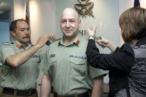 NEW RANK:  Major General Rhys Jones receives his rank slides from Chief of Defence Force Jerry Mateparae and his wife  Debbie Jones, during his promotion to major general this week.