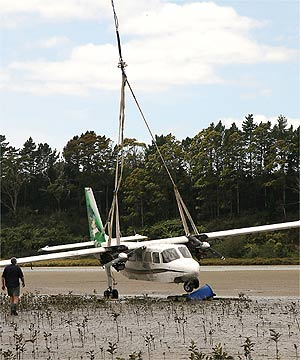 LIFT-OFF: The Britten Norman Islander aircraft, weighing 2.3 tonnes, being airlifted off mud flats after it crash landed in Tauranga last December.