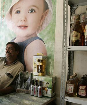 NO FEAR: A liquor store owner waits for customers inside his shop in Baghdad. Liquor store owners who have been bombed by suspected Muslim militants opposed to alcohol consumption are making profits again after shutting their shops for months.