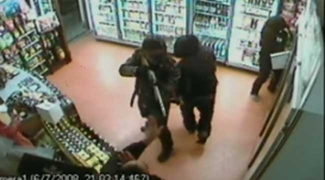 GUNPOINT: The three robbers caught in action at the Manurewa liquor store by closed circuit television.