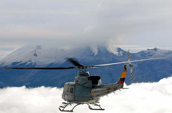 RUMBLING: A helicopter of the Colombian Air Forces flies near the active volcano Nevado del Huila.