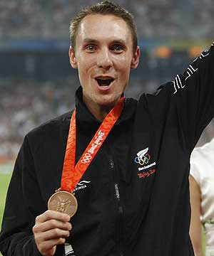 PRICELESS MOMENT: Nick Willis shows off his bronze medal from the 1500 metres, but now the moneymen are moving in to assess New Zealand's effort in Beijing.
