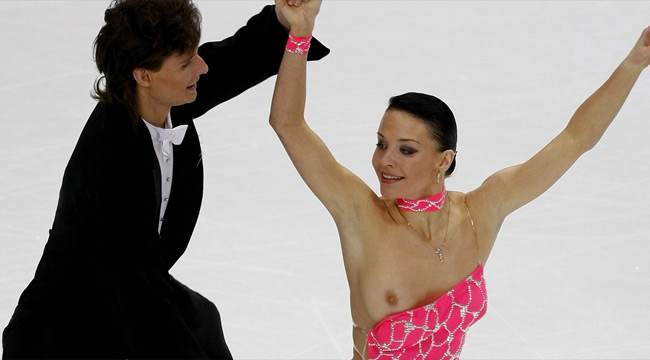 OOPS: Ekaterina Rubleva of Russia loses her top as she performs with Ivan Shefer during the Ice Dancing Compulsory Dance at the European Figure Skating Championships in Helsinki.