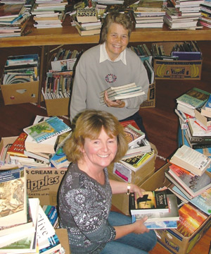 BIG BOOK SALE: Librarian Melanie Bovey, front, and library volunteer Gillian Futcher, both from the Marton Library, had the mammoth task last week of sorting out 5000 books for Saturday's book sale at the Bulls Town Hall. The sale, with books from the Bulls, Marton and Taihape libraries, is held every couple of years. This year it was timed to be held in conjunction with the Bulls Library's 90th birthday celebrations.