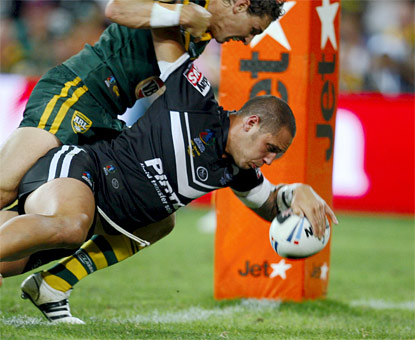 BREAKING THROUGH: Jeremy Smith scores the Kiwis' opening try of the rugby league World Cup final.