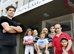 TAKING A STAND: Mevlana Cafe owner Mustafa Tekinkaya, left, with family and friends.
