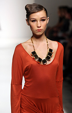BURNT ORANGE: A model wears an outfit by Kirrily Johnston.