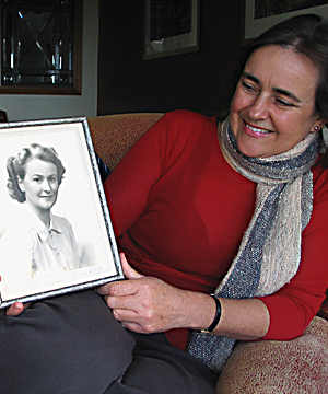 IN MEMORY: Christine Caughey holds a framed photo of her late mother Catherine Caughey, taken at her engagement.