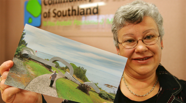 BLUFF LINK: Bluff Community Board chairwoman Jan Mitchell showing off an artist's impression of an Anchor Chain sculpture, set to be installed at Stirling Point in Bluff this year.