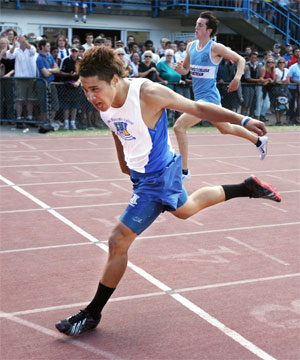 John Brooks, of St Pat's Town, powers home in the under-16 400m race last year. Brooks also won the 100m and 200m.