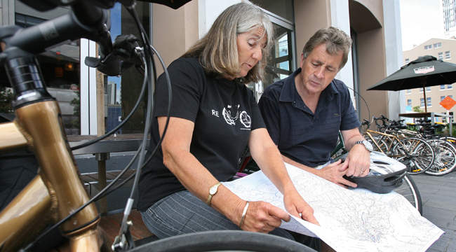 ROUTE PLANNING: Cycle Action Auckland co-chairwoman Barbara Cuthbert and Auckland Regional Council chairman Mike Lee look over one of five new cycle maps.