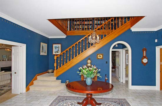 GRAND ENTRANCE: The marble-floored foyer and rimu staircase.
