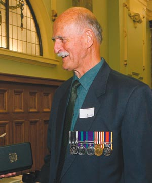 DESERVED RECOGNITION: Ron Chippindale receives the New Zealand Special Service Medal last year for his work on the Mt Erebus investigation.