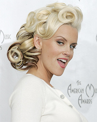 ALL WHITE: Jenny McCarthy has been named among the top 10 best ever Playboy bunnies.