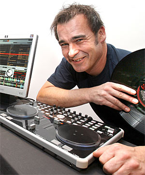 SCRATCHING AN ITCH: Scott Bulloch of Serato Audio Research with some old records and the DJ equipment called Itch.