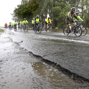 Mind the puddles: Cyclists taking part in the Central South Island Charity Bike Ride cope with the   rain just south of the Waimate Gorge.