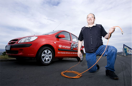 PLUGGING IN: Australian Ross Blade with one of his retro-fitted BEV (blade electric vehicles).