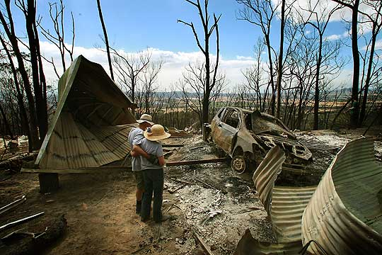 GONE: Errol Shearsby and his wife Beverley survey the remains of their family home in Christmas Hills.